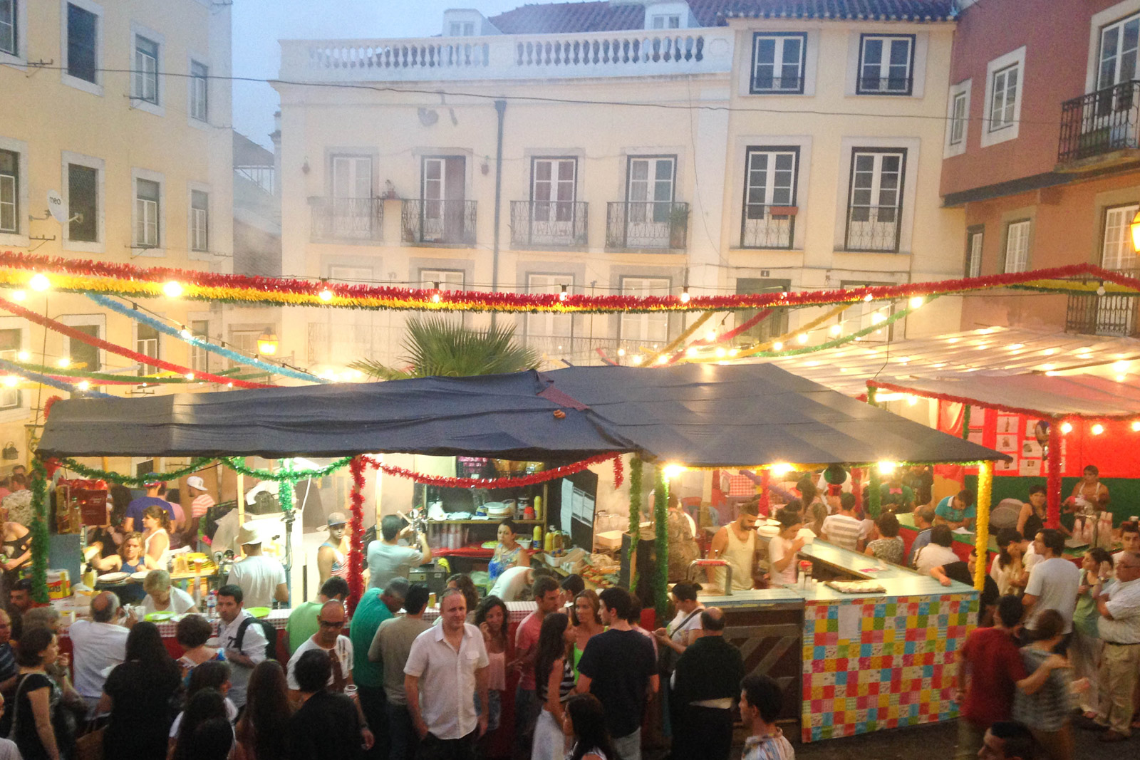 Outdoor evening restaurants and food set up in the squares of Alfama, Lisbon