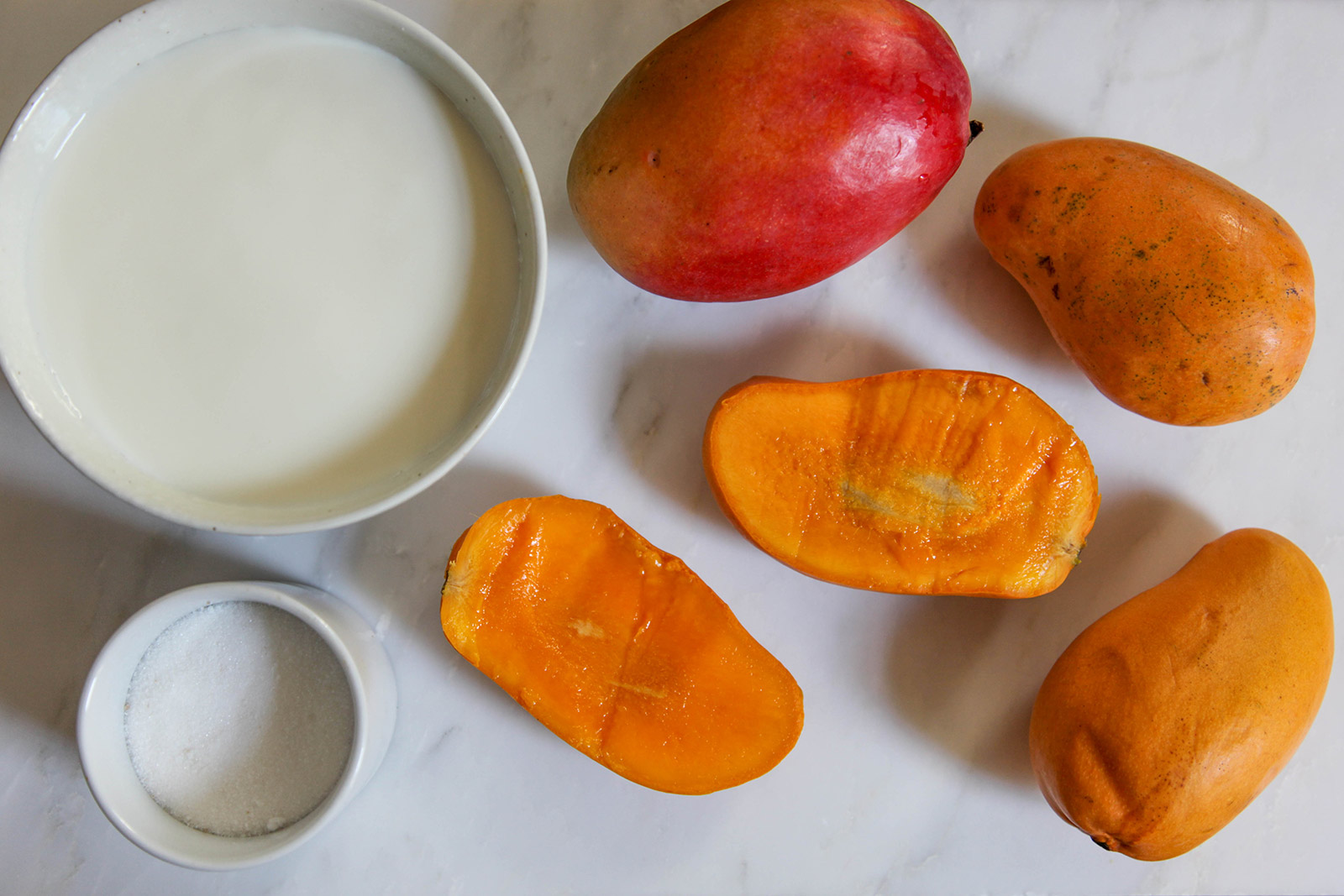 "Ingredients for ""aamer pona"", simple heavenly dessert of sweet mango in creamy milk dessert of sweet mango in creamy milk"