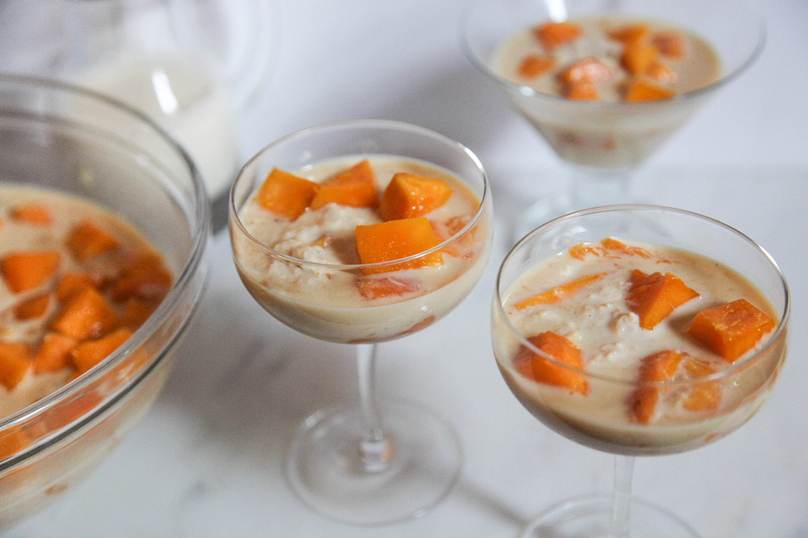 simple dessert of sweet mango in creamy milk