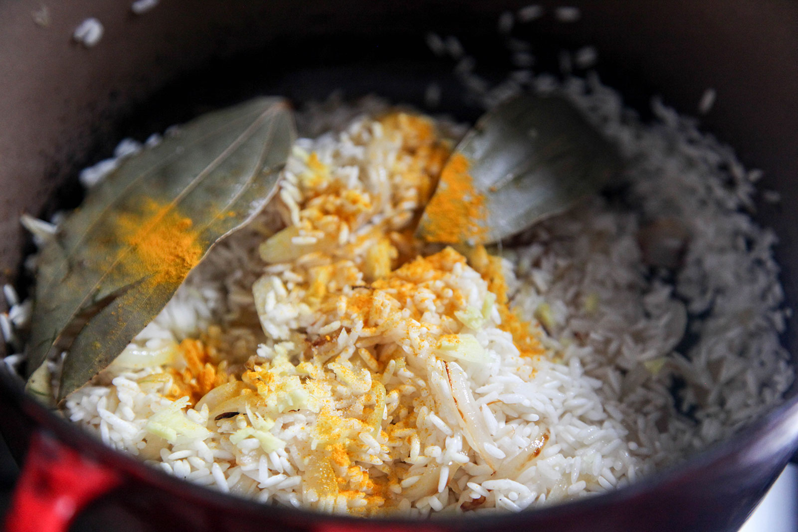 Frying sticky rice with spices for Sylheti Biron Polau