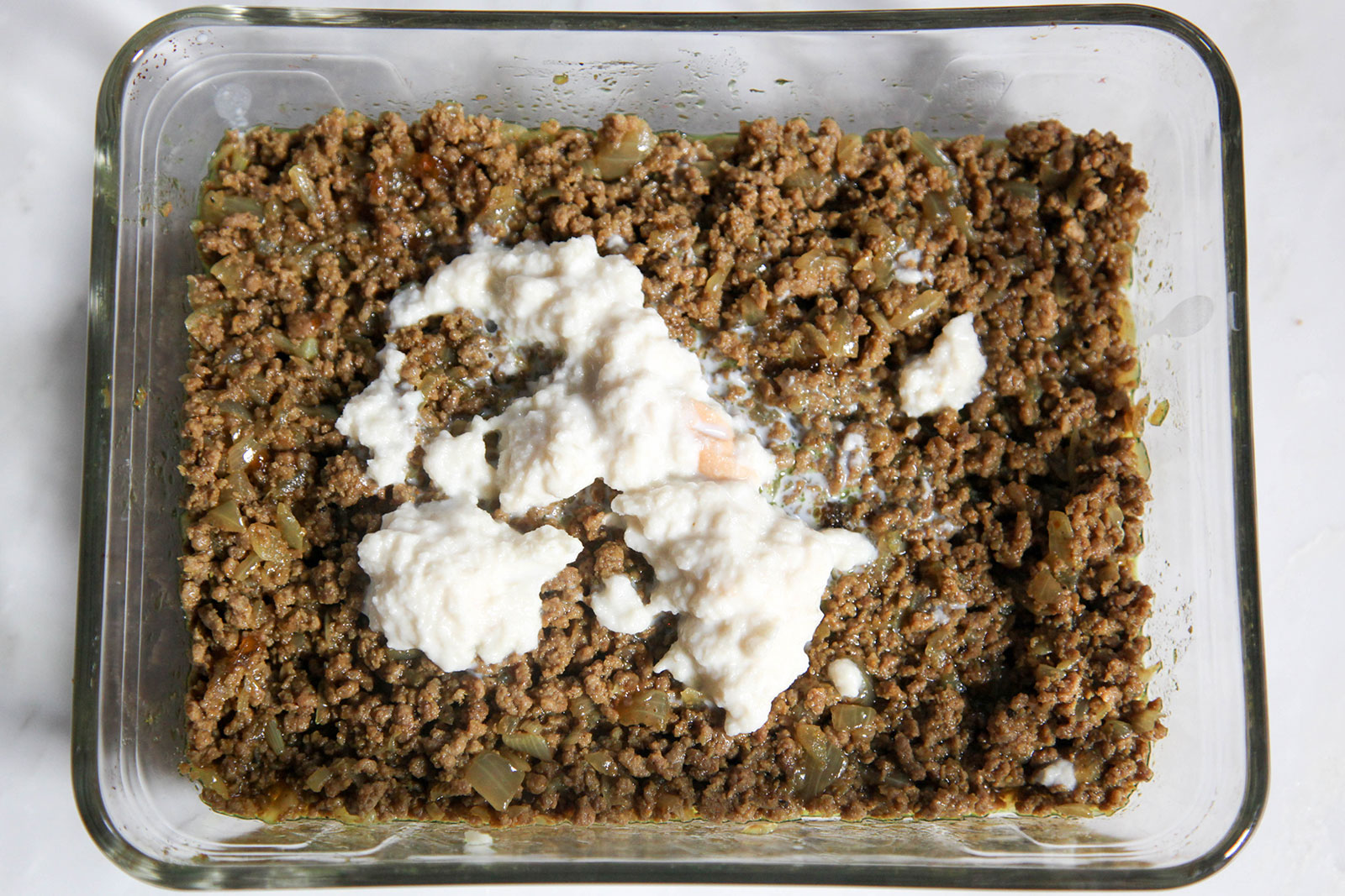 bread drained of milk and mashed, for mixing with ground meat