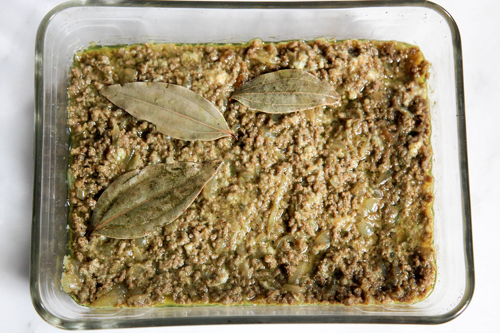 ground meat mixed with mashed bread, and with bay leaves - ready for baking