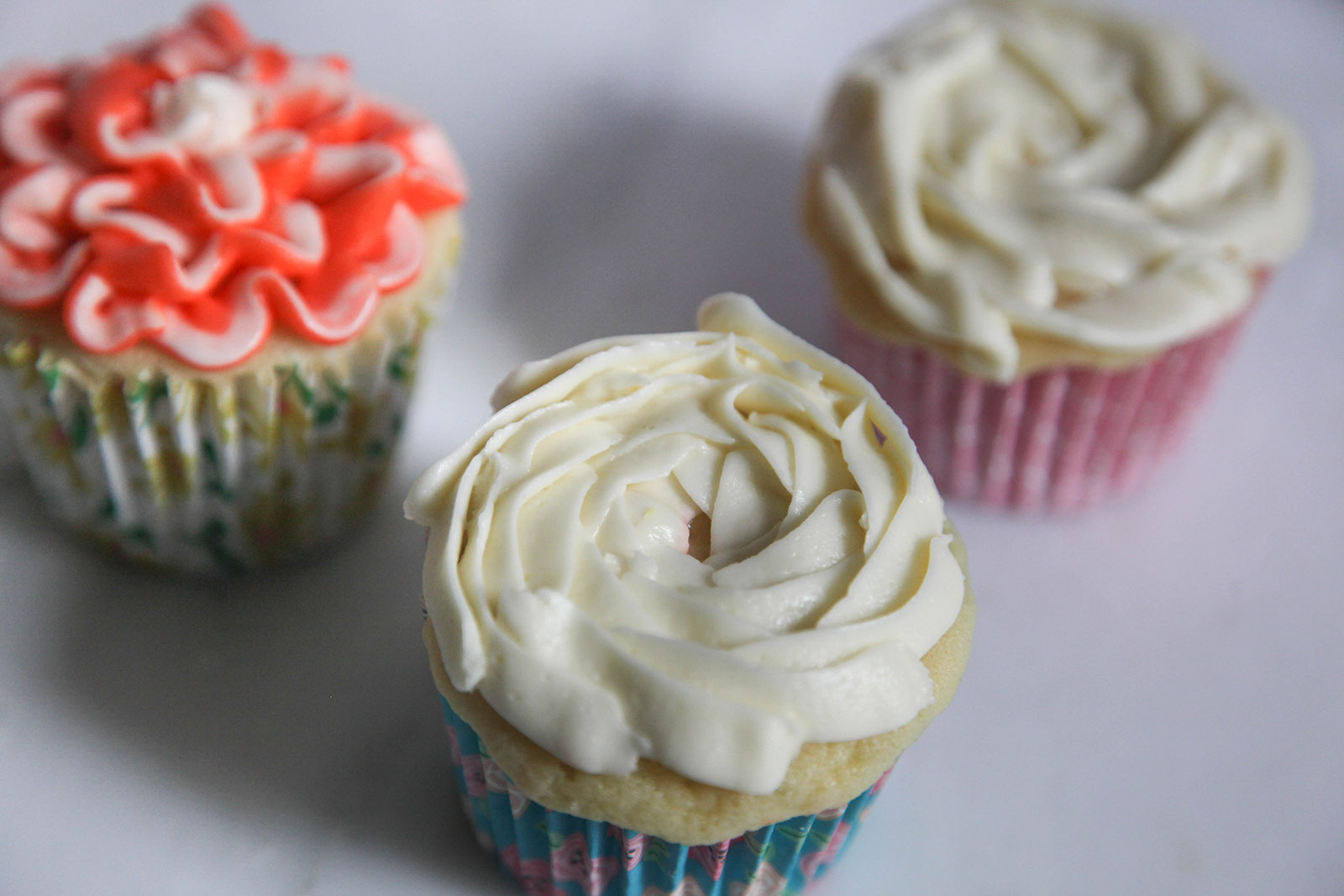 moist fluffy cupcakes with white rosette decoration