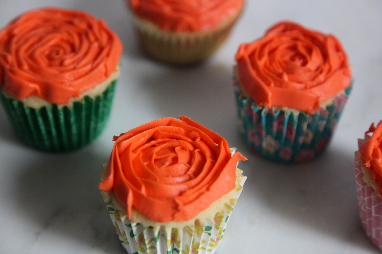 moist fluffy cupcakes with rosette decoration