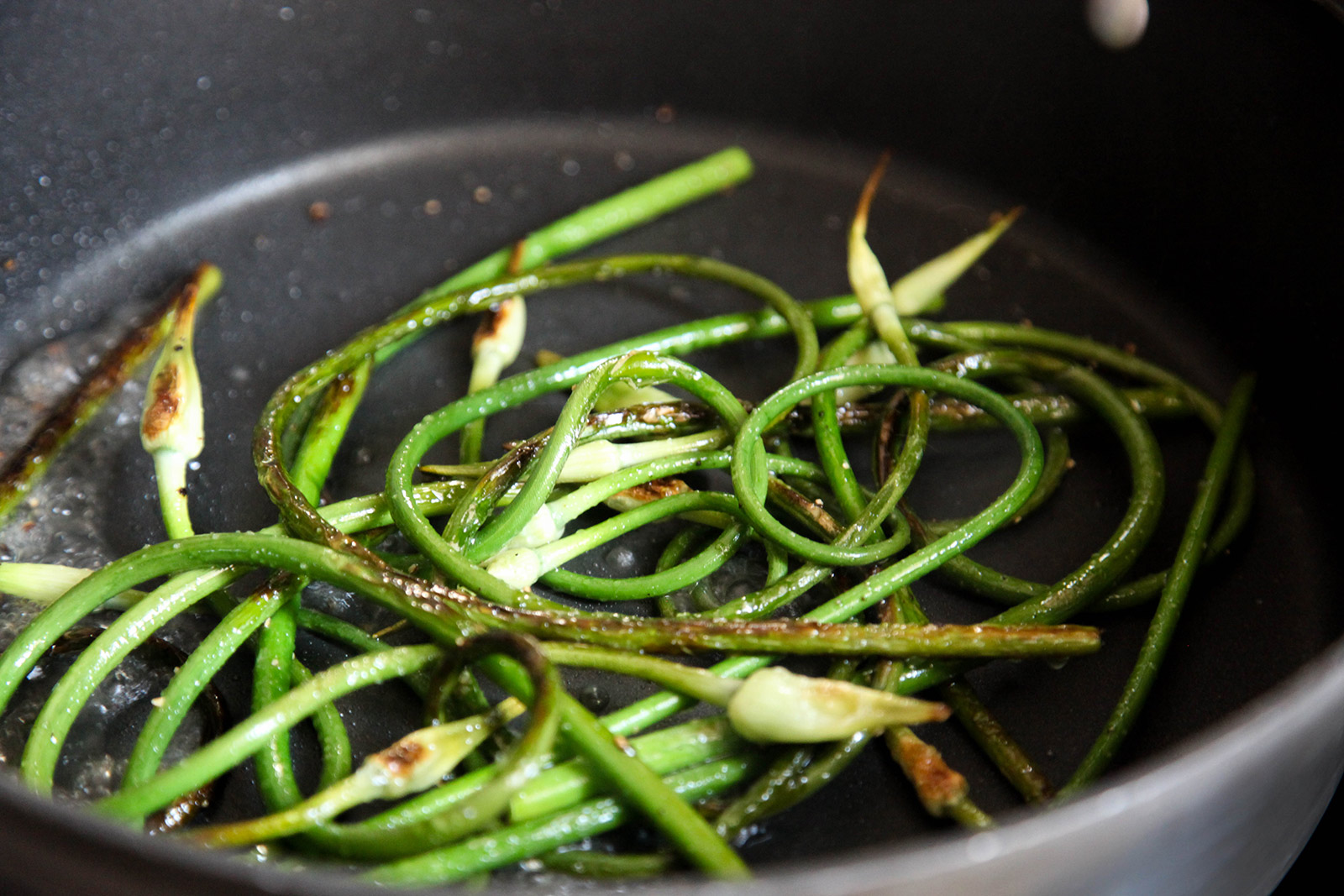 sauteeing garlic scapes with olive oil, salt & pepper