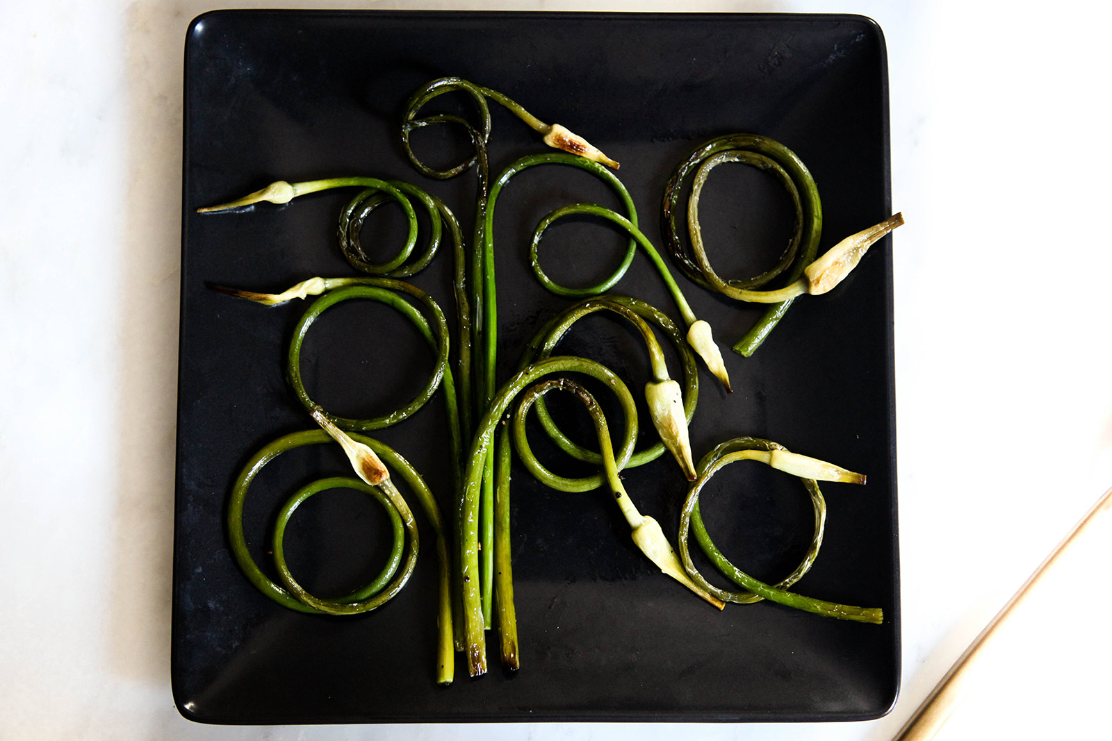 Garlic Scapes Sauteed with Olive Oil, Sea Salt & Freshly Ground Pepper