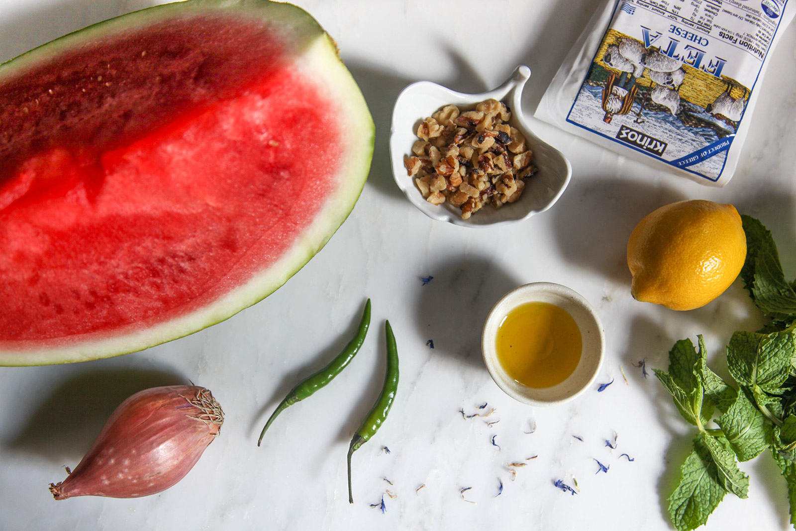 Ingredients for making Watermelon Salad with Mint, Feta, Walnuts & a Little Bit of Spicy Kick