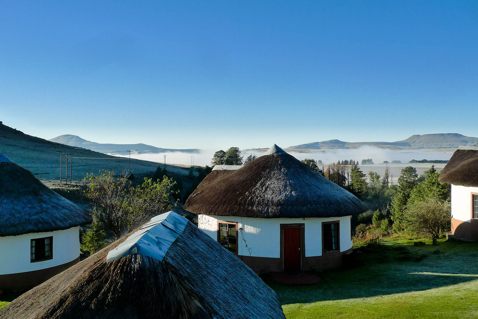 morning view of circular huts from our lodge in the Drakensberg